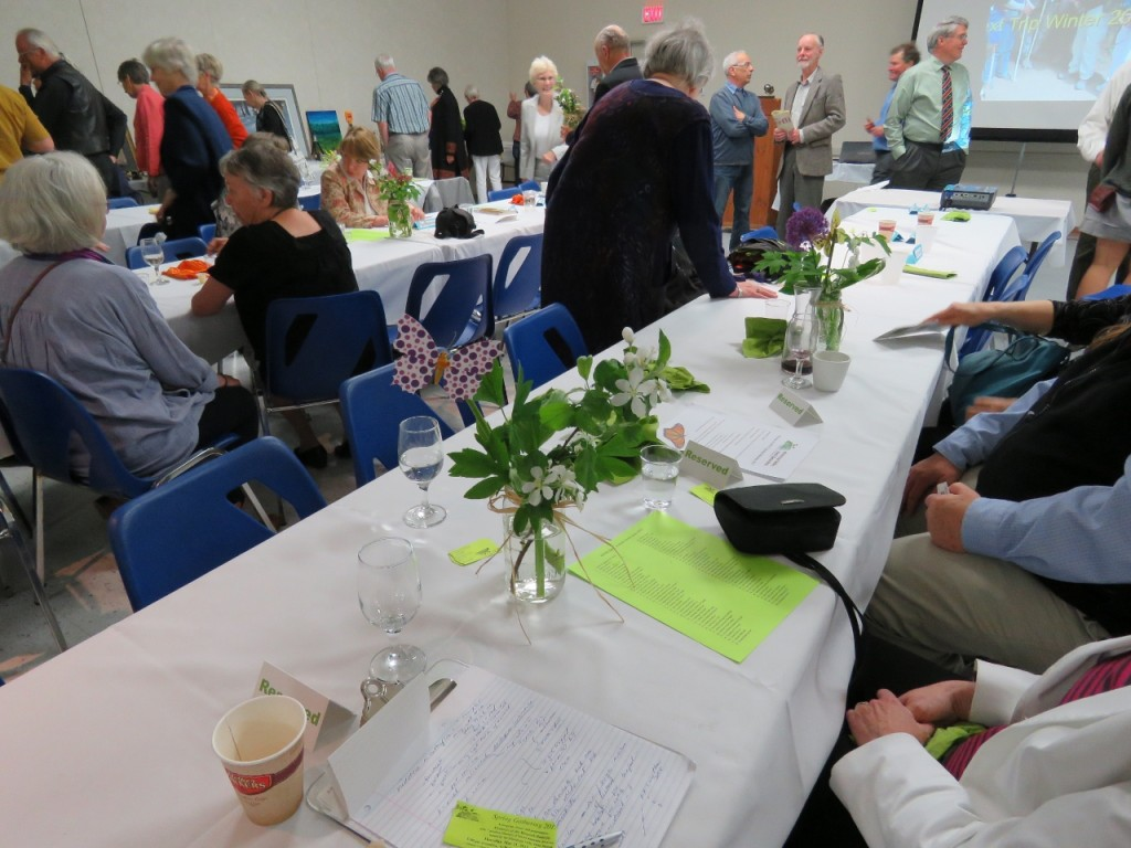 The Almonte Civitan hall was a flourish of butterflies, spring wildflowers and brilliant 'butterfly & spring' colors of green, orange and yellow sprouting from sparkling glasses for MVFN's 2015 Spring Gathering and Mysteries of the Monarch presentation. Photos Pauline Donaldson