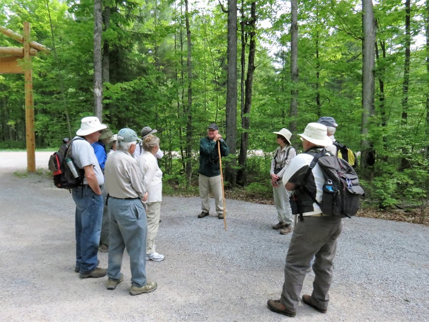 Group of twelve assemble and talk before walk. photo Howard Robinson